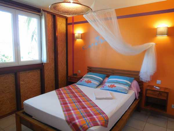 The bedroom of the cottage Caraïbes, in the rentals Lamateliane