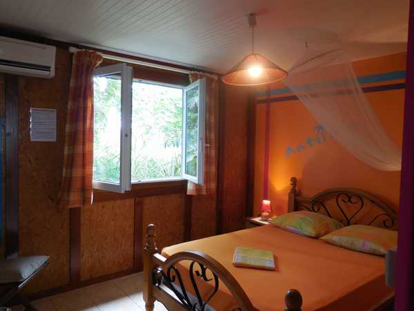 The bedroom of the Antilles lodging, in Lamateliane cottages