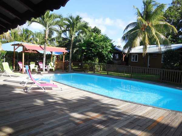The pool and deck in front of the 4 cottages Lamateliane