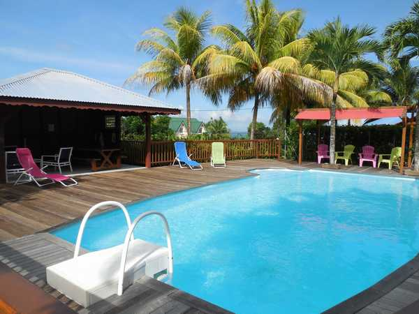 The large swimming pool lined with an exotic wooden deck in Lamateliane