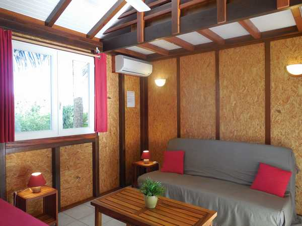 The air conditioned and ventilated living room of each lodging